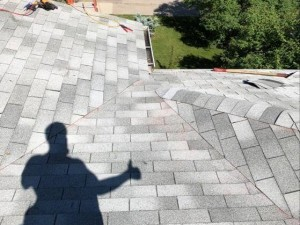 completed roof with thumbs up